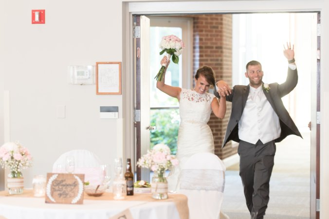 The newlyweds make their grand entrance into the reception room through the Burlington Room doors.