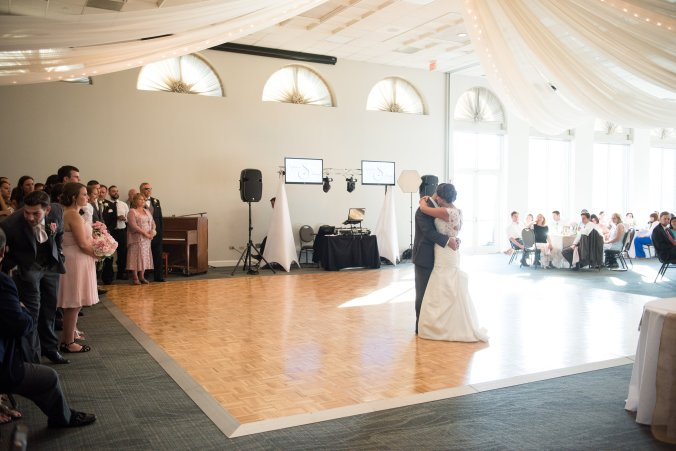 They chose our 24' x 24' dance floor underneath the beautiful ceiling drapery with lights to soften the room.